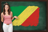 Beautiful and smiling woman showing flag of Congo on blackboard