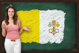 Beautiful and smiling woman showing flag of Vatican City on blac