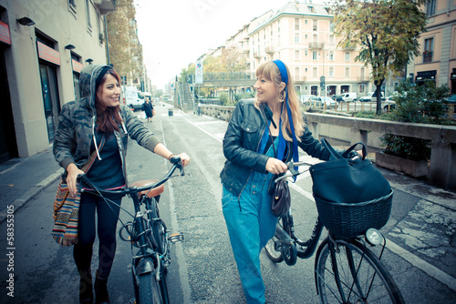 two friends woman on bike