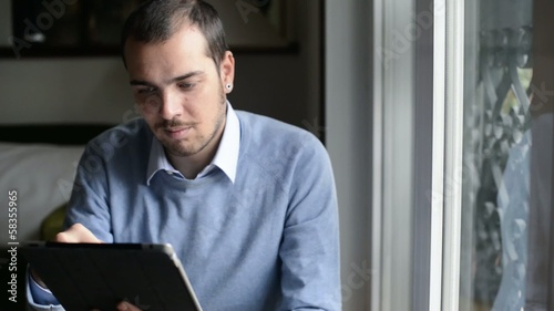 elegant business multitasking multimedia man using notebook at h