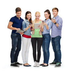 smiling students using smartphones and tablet pc
