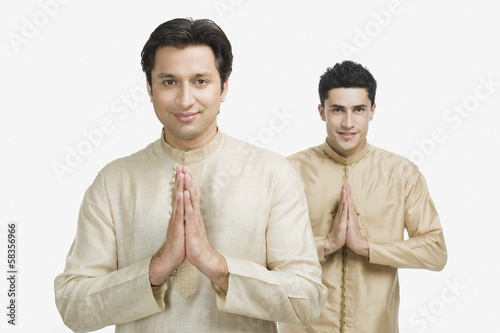 Two men in prayer position