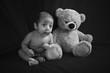 Baby boy sitting with a teddy bear