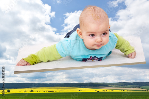 Baby lying on the flying board