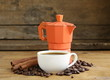 Coffee beans and cup of espresso on vintage background