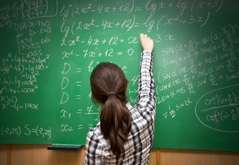 student near blackboard