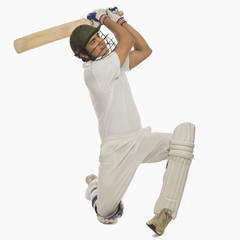 Cricket batsman playing a cover drive