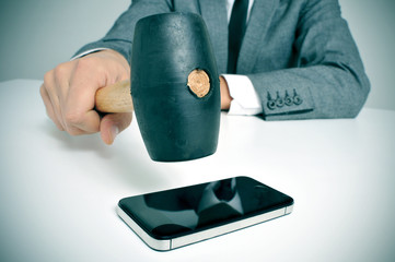 businessman broking a smartphone