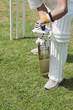 Cricket batsman playing a defensive stroke