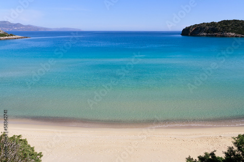 Fototapeta Idyllic and secluded turquoise water bay beach east of Crete