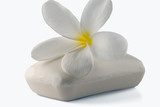 Close-up of Frangipani flower with a bar of soap