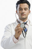 Doctor examining with a stethoscope