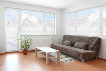 Living room with beautiful view to winter mountain.