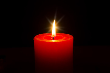 One red burning candle