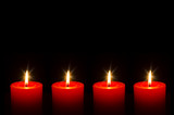 Four red burning candle for Advent