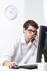 Man working in office on the phone