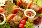 tasty grilled meat and vegetables on skewers, close up