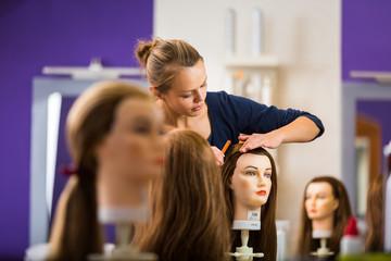 Pretty female hairdresser/haidressing apprentice