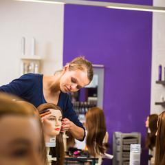 Pretty female hairdresser/haidressing apprentice/student trainin