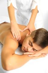 Young man having back massage close up