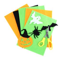Bright felt and handmade Halloween decorations, isolated