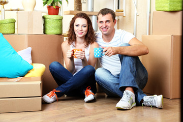 Young couple celebrating moving to new home