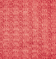 red knitted fabric as a background. macro