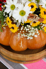 Beautiful autumn composition in pumpkin on fabric background