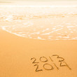 2013 - 2014, written in sand on beach texture