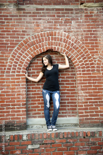 City Teen Girl Framed in Brick