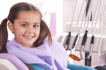 pretty little  girl in dentist office