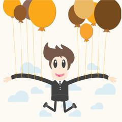 Businessman holding a balloon