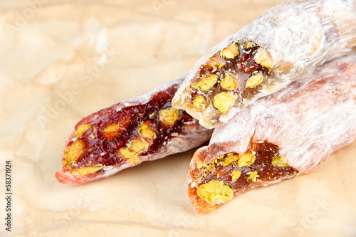 Tasty oriental sweets (Turkish delight), on brown background