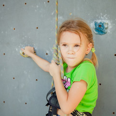 Little Girl Climbing Rock Wall