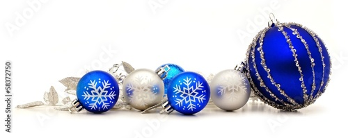 canvas print picture Collection of blue and silver Christmas baubles forming a border