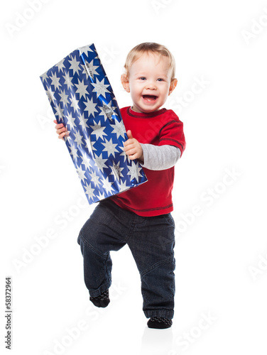 Happy Toddler Holding Gift on White