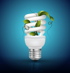 Energy saving lamp with green leaves on blue
