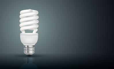 White energy saving lamp on black background