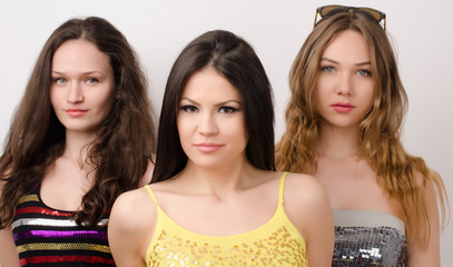 Portrait of three beautiful women, one blonde and 2 brunettes