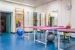 Leinwanddruck Bild - Empty room in physiotherapy clinic
