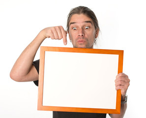 man is showing on a white signboard