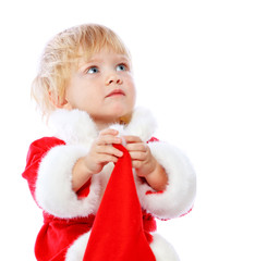 little girl dressed in Santa Claus