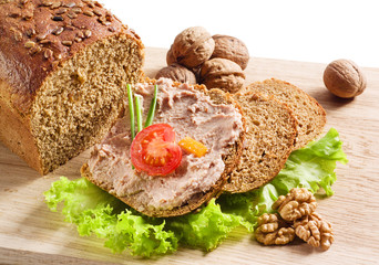 Pate on bread. with tomato and nuts