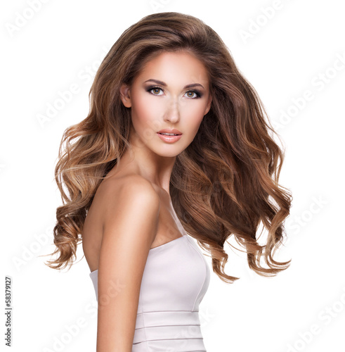 A beautiful young woman with moving long wavy hair