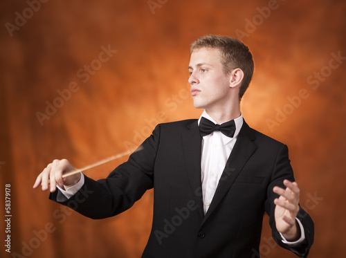 Portrait of a young orchestra conductor