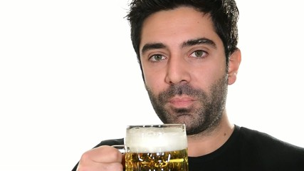 young man drinking beer, close up