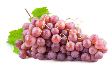 Fresh red grapes with leaves. Isolated on white