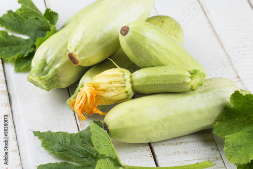 Fresh marrow on wooden table
