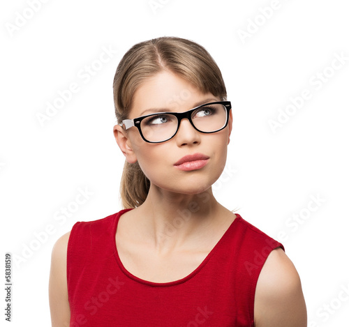 Attractive blonde in stylish specs looking aside, isolated