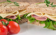 Fresh ham and cheese on white sandwich in rustic kitchen setting - 58382165
